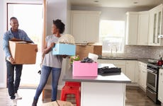 Couple moves into a new home.