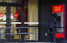 A woman uses a Wells Fargo ATM.