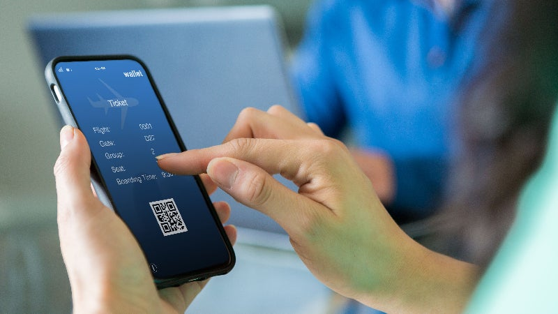 Person looking at plane ticket on phone