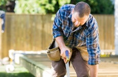 Man working on home improvements outdoors.