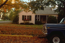 Truck outside of house on a fall day