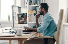 man at computer in home office