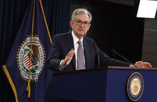 Federal Reserve Chairman Jerome Powell talks to reporters at press conference
