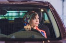 Woman sitting in car at dealership