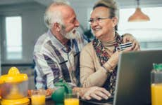 An older couple researches online.