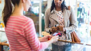 Can a business charge for using a credit card?