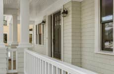 Shot of a pristine porch with white railing.