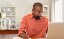 Man budgeting on his laptop