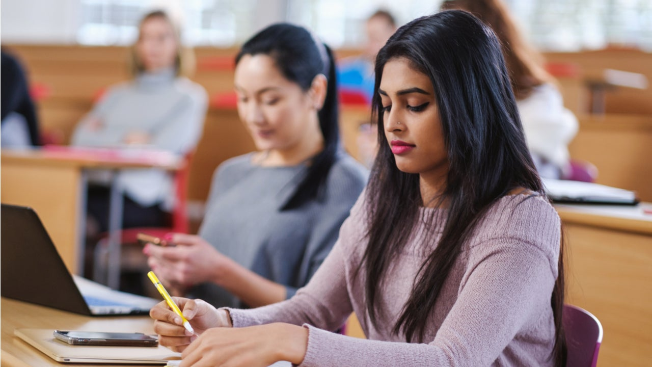 College students take notes in a classroom