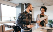 Couple review paperwork in kitchen