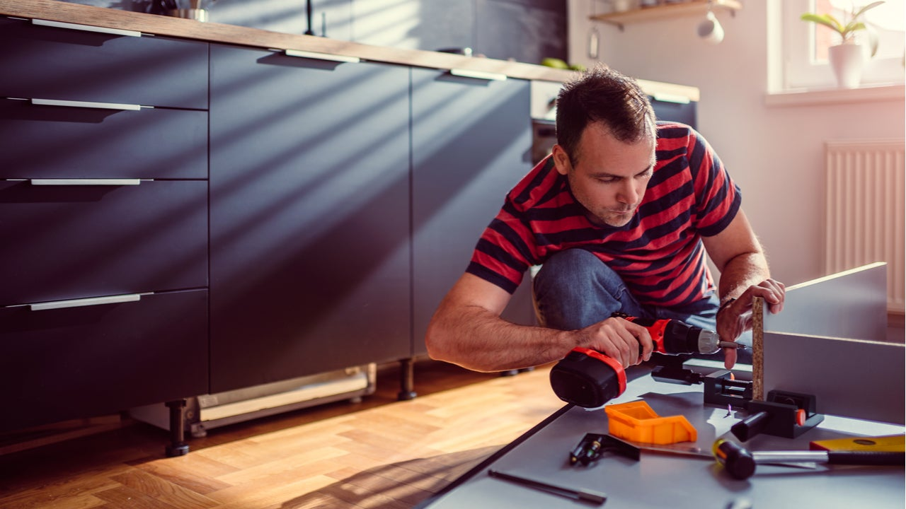 Man works on a kitchen construction project