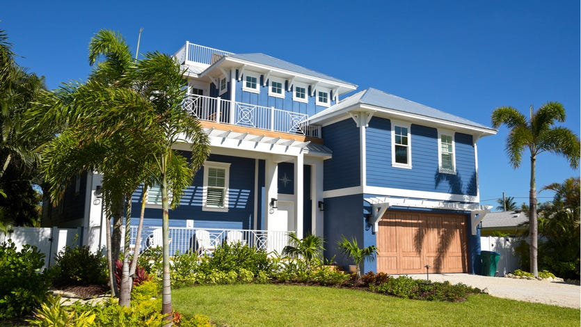 Blue home with palm trees
