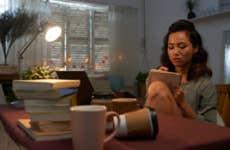 College student studies in dorm room.