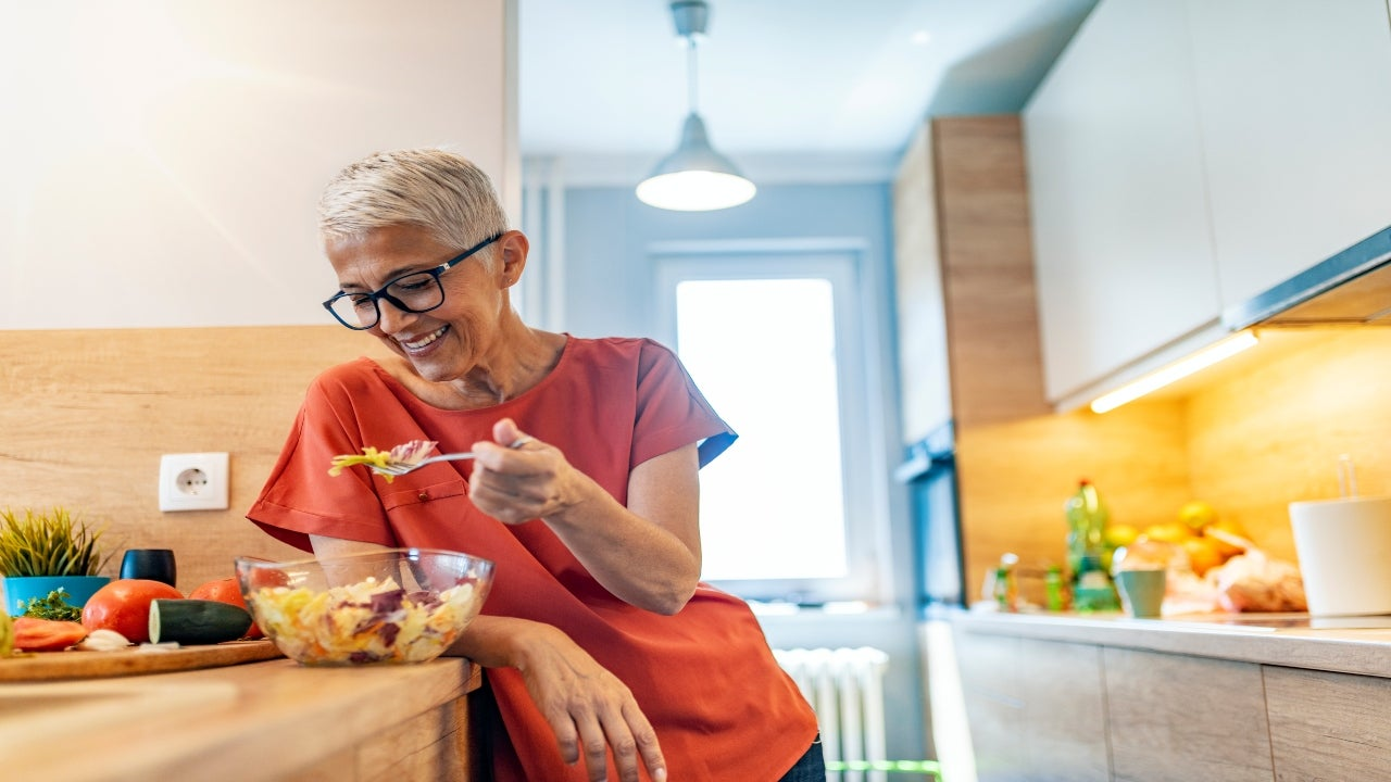 A retiree at home eating lunch