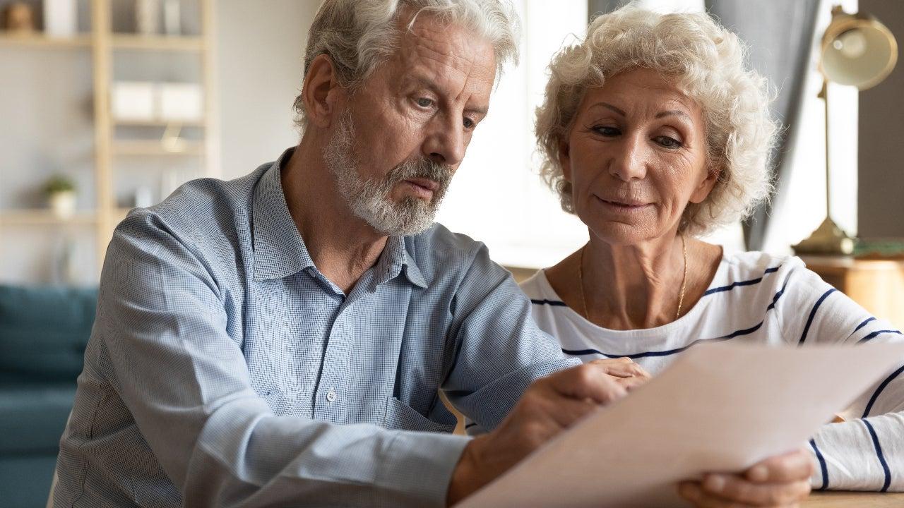 An older couple reviews a bill.