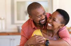 A middle age Black couple hugs each other