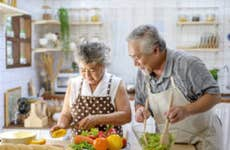 An older couple spends some time together cooking and preparing dinner.