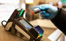 Person scanning credit card