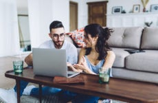 A couple sits together to do some research.