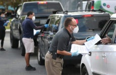 Employees hadn out unemployment applications to people in their vehicles