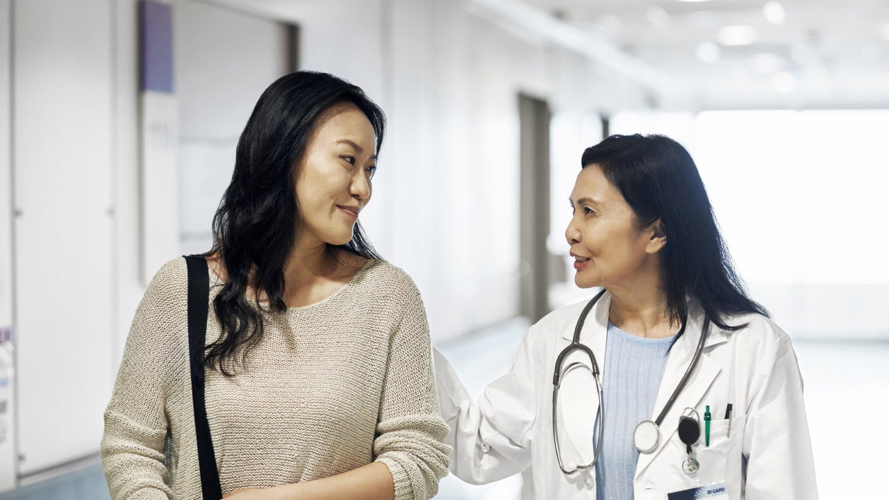 A woman consulting her health specialist.