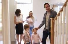 A real estate agent gives a tour of a home