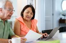 A White man and Asian woman discuss finances