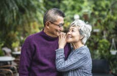 Older Asian couple enjoying time together in the park.