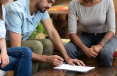 Borrowers meet with a loan officer to refinance their mortgage.