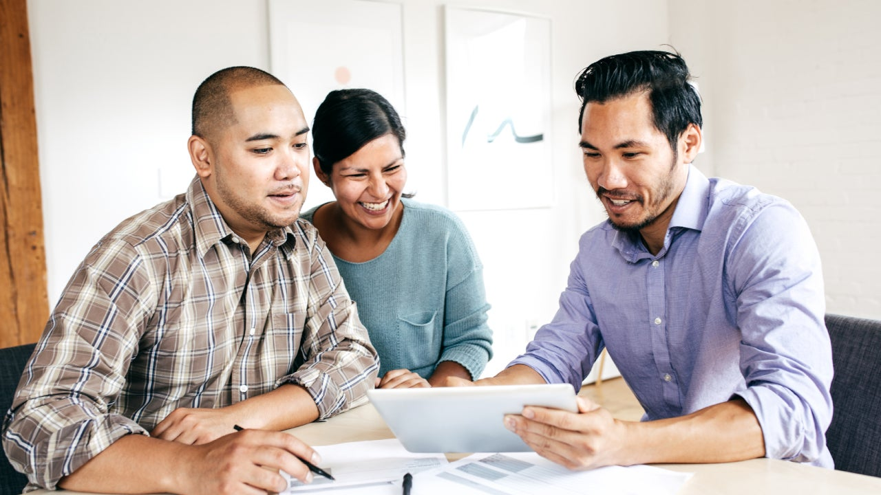 A couple consults with a financial expert.
