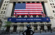 A shot of the fearless girl statue on front of the New York Stock Exchange