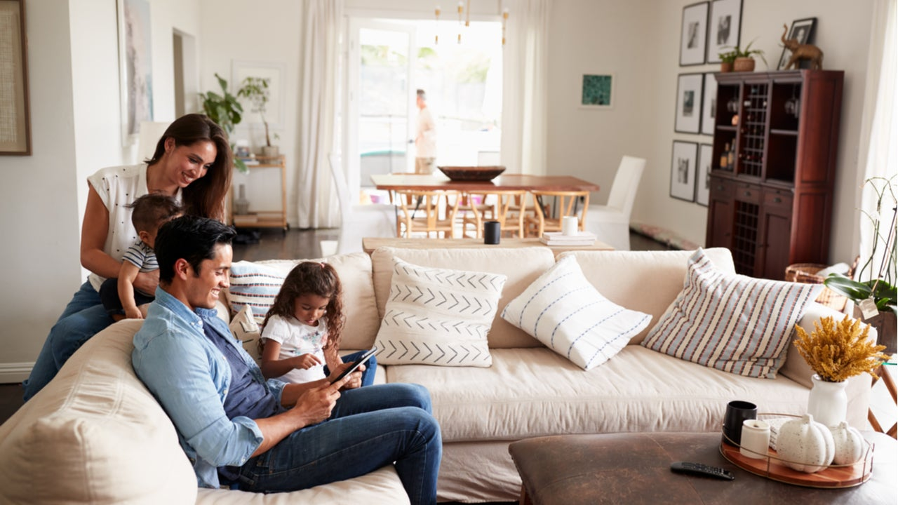 A family hangs out in their living room