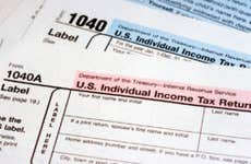 A photo of two IRS 1040 forms