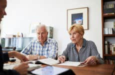 an older White couple talk with an adviser