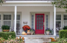 The front porch of a home with planters and curb appeal