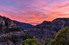 Sunset in the Colorado mountains with the sky during a nice peach color.