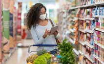 Woman shopping at the grocery store wearing a facemask