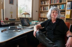 A middle-aged White freelancer sits at her desk