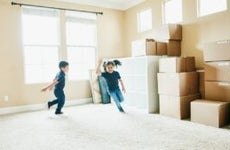 Children playing in an empty house on moving day