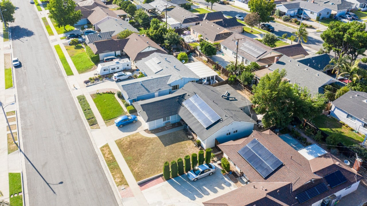 An aerial view of a neighborhood with single-family homes