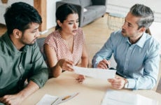 A couple chats with their financial adviser