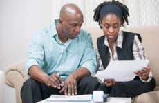 A Black couple reviews financial documents