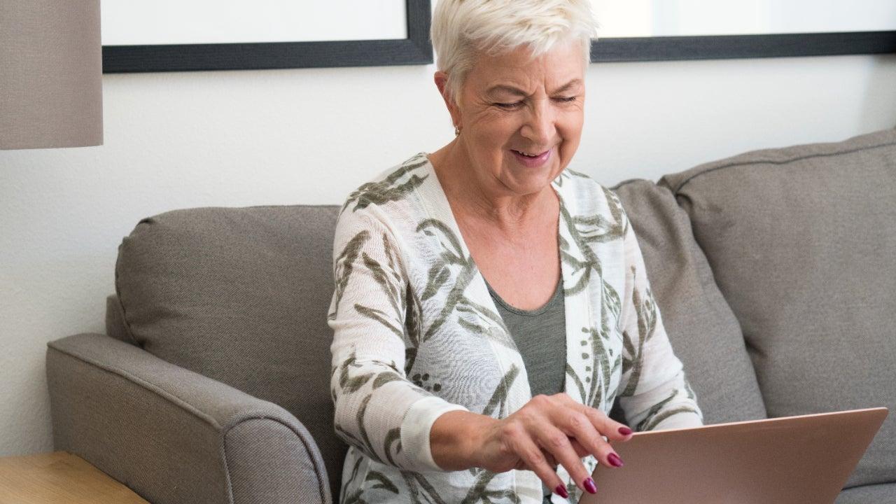 A senior works on her laptop.