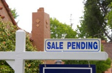 A closeup of a for-sale pending sign