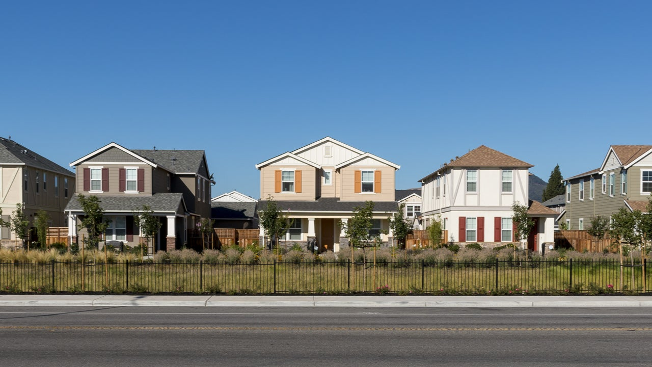 A row of single-family homes along a major thoroughfare
