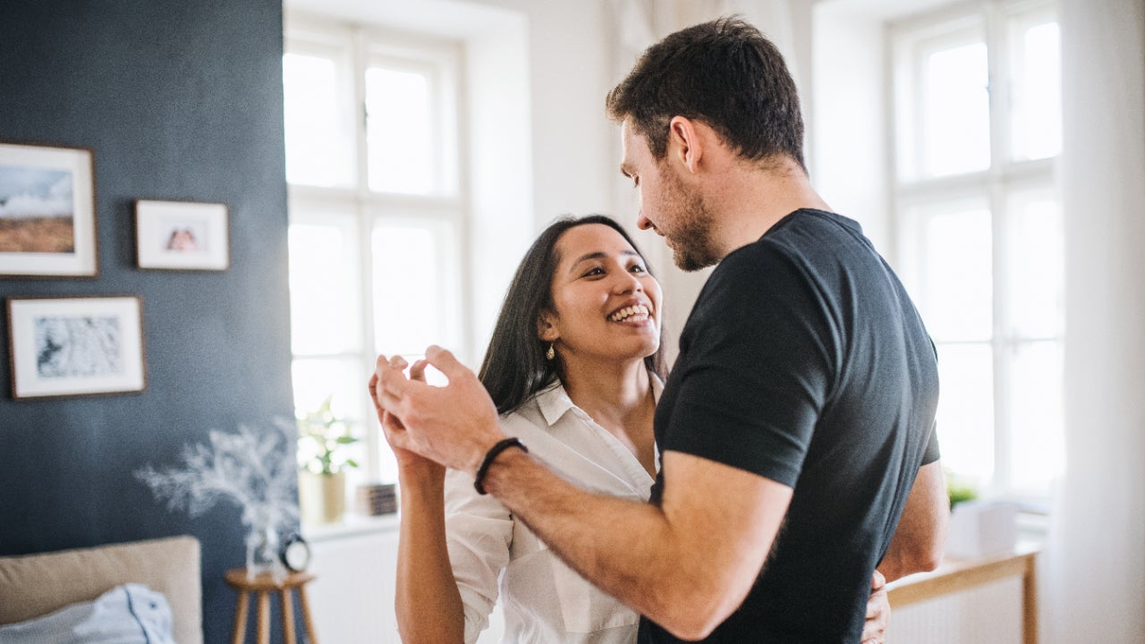A White couple dances in their living room