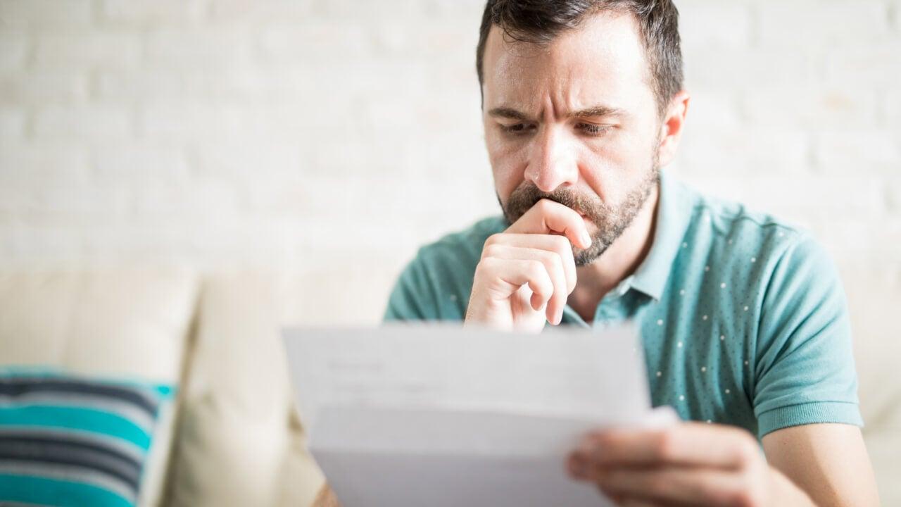 Man reading mail