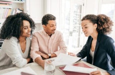 A Black couple speaks to a Black financial expert about their mortgage.