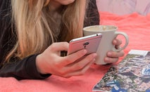 A young woman works on her smartphone.