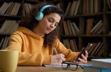 Teen student works on homework